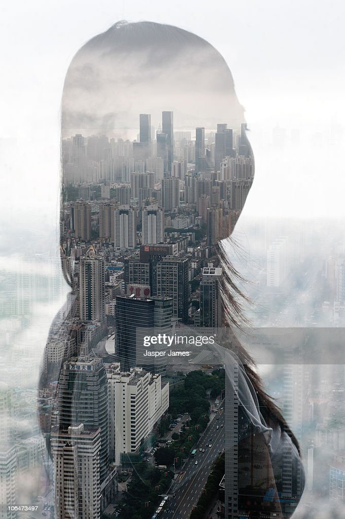 Woman looks over city : Stock Photo