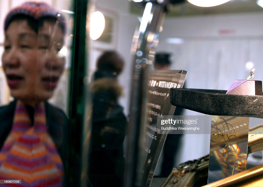 A woman looks piece of diamond shape chocolate with a 2.3 carat diamond in the centre on display at a Hanshin Department Store on February 6, 2013 in Osaka, Japan. The chocolate is priced at 3 million yen (about USD 32,456), making it the world's most expensive chocolate.