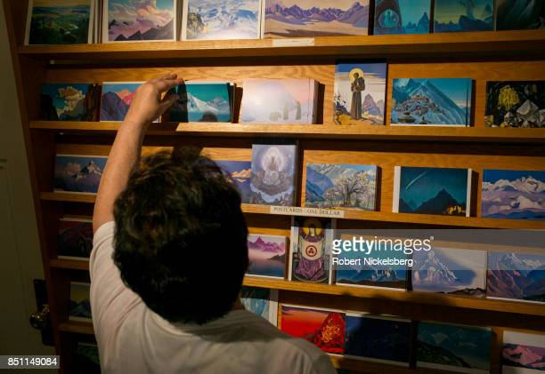A woman looks through a postcard selection of paintings done by Nicholas Roerich September 16 2017 at the Nicholas Roerich Museum in New York City...