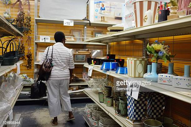 A woman looks through merchandise at a discount store on September 14 2011 in New York City New Census Bureau figures released today reveal that 308...