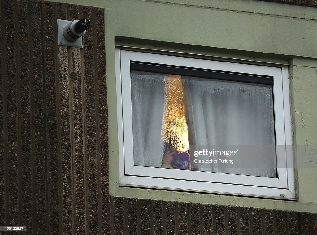 A woman looks through the window of her home on the Falinge Estate, which has been surveyed as the most deprived area in England for a fifth year in a row, on January 8, 2013 in Rochdale, England. According to data provided by the Department for Communities and Local Government, 72 per cent of people in the local area are unemployed and seven per cent have never had a job. Four out of five children on the estate are living in poverty, with the area having one of the highest teenage pregnancy rates in the country. During today's House of Commons debate, the government urged MPs to back their planned 1 per cent cap on annual rises in benefits and some tax credits for three years from next April. Benefits for people of working age have historically risen in line with the rate of inflation.