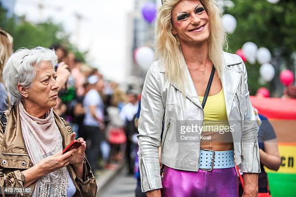 A woman looks to a participant who attends a Christopher Street Day parade on June 27 2015 in Berlin Germany Similar marches are taking place in...