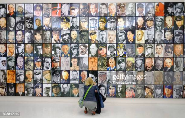 A woman looks to the artwork 'Real Nazis' by artist Piotr Uklanski on June 8 2017 in Kassel Germany The documenta 14 is the fourteenth edition of the...