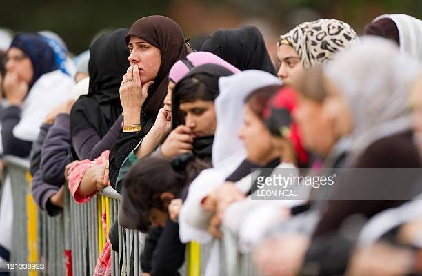 A woman looks towards the stage as a Muslim cleric addresses the people in Summerfield Park in Winson Green Birmingham during a prayer service on 18...