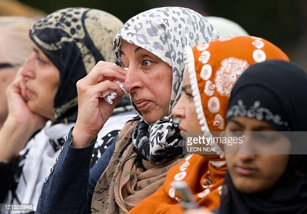 A woman looks towards the stage as a Muslim cleric addresses the people in Summerfield Park in Winson Green Birmingham during a prayer service on...