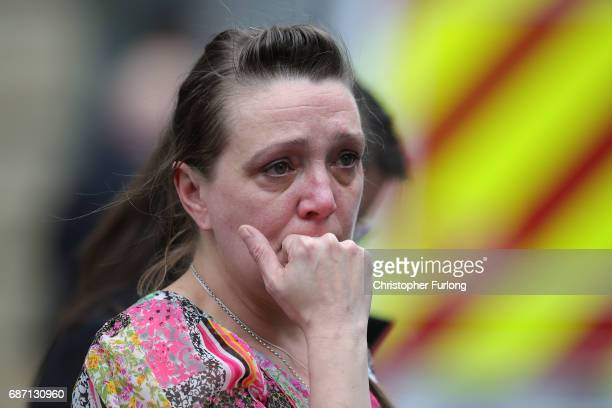A woman looks upset after police avacuated the Arndale Centre on May 23 2017 in Manchester England An explosion occurred at Manchester Arena as...