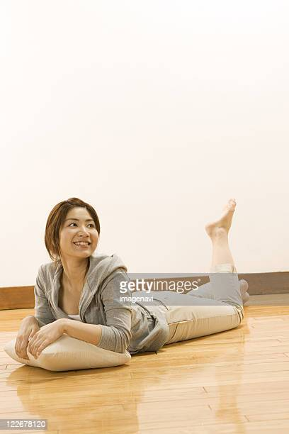 Woman Lookup up while lying on floor