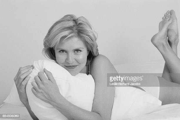 Woman Lounging About in Bed