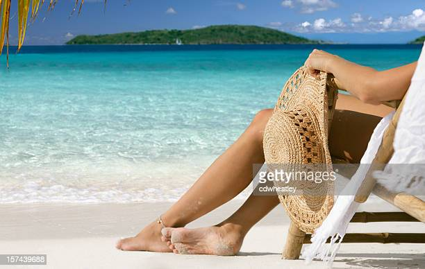 woman lounging at beach in paradise