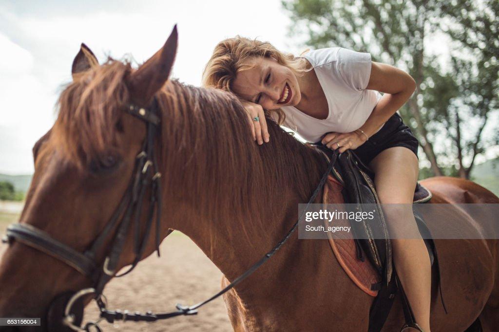 Woman loves horses : Stock Photo