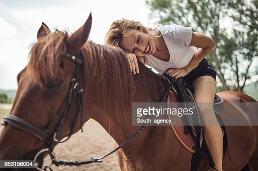 Woman loves horses : Stock Photo