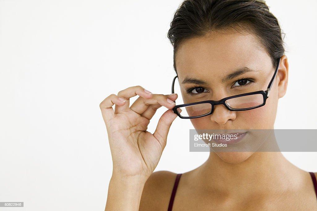 Woman lowering glasses