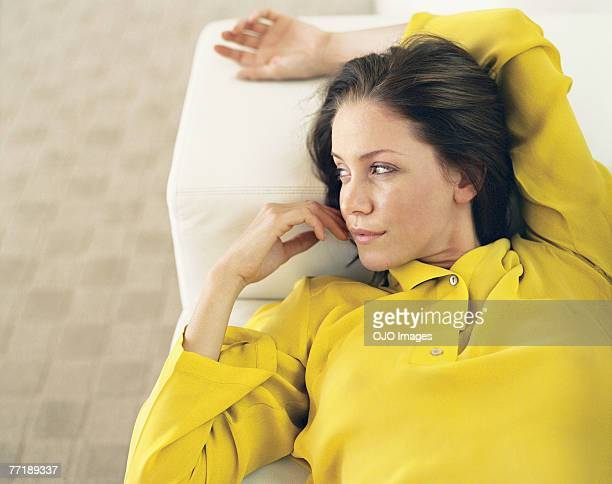 A woman lying back on a couch