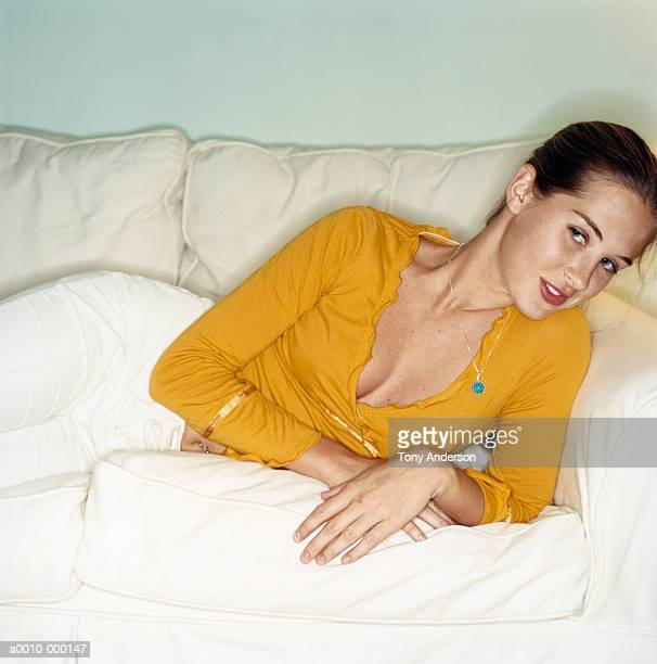 Woman Lying Casually on Sofa