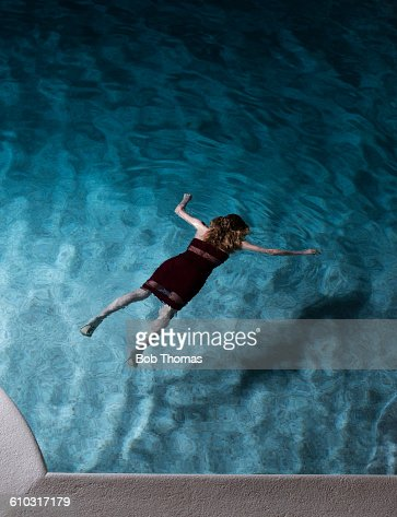 Woman Lying Dead In A Swimming Pool Stock Photo Getty Images