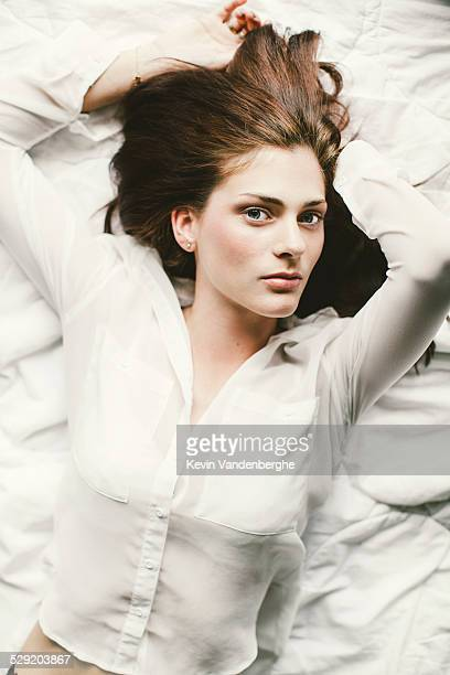 Woman lying down in bed