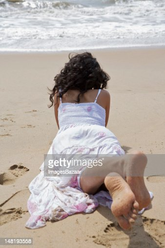 Woman lying down on beach : Stock Photo