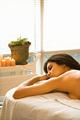Woman lying down on massage table
