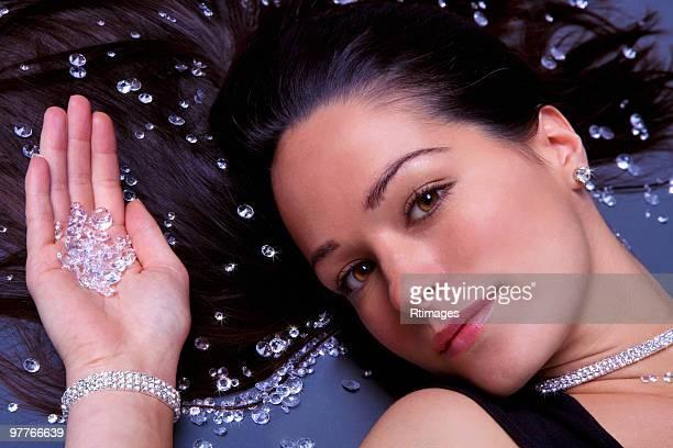 Woman lying down with diamonds