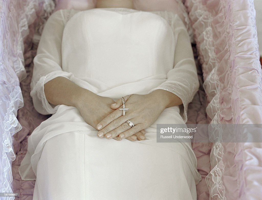 A woman lying in a coffin