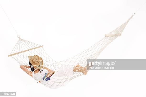 Woman lying in a hammock