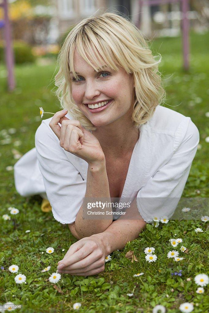 woman lying in garden : Stock Photo