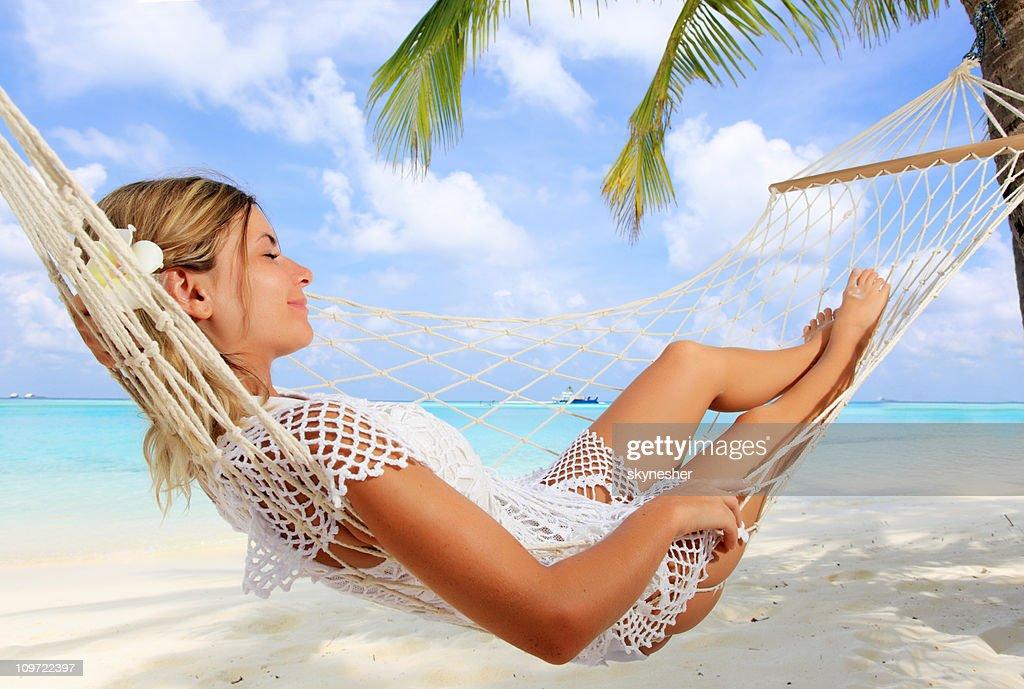 Woman lying in hammock near the sea. : Stock Photo