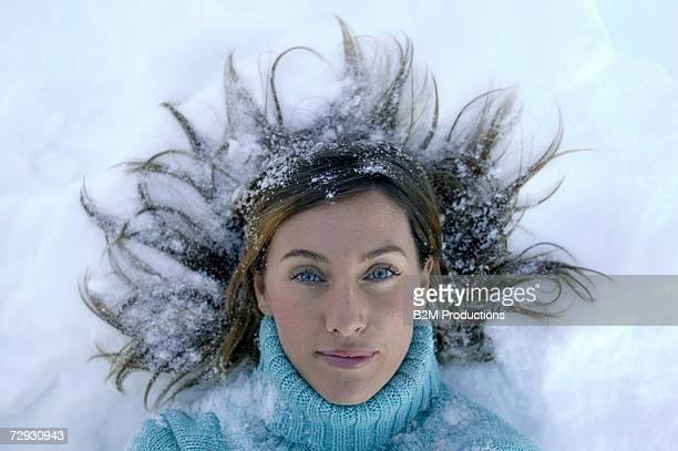Woman lying in snow, portrait