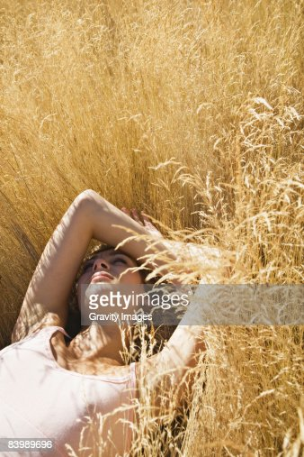 Woman Lying in the Grass, Looking at the Sky : Stock Photo