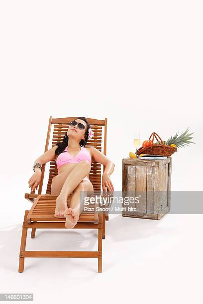 Woman lying on beach chair