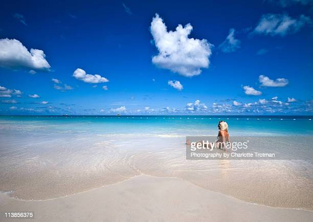 Woman lying on beach in the water