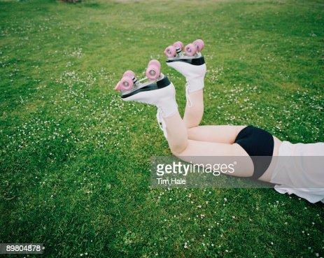Pink Childrens Roller Skates Lying On Footpath Against