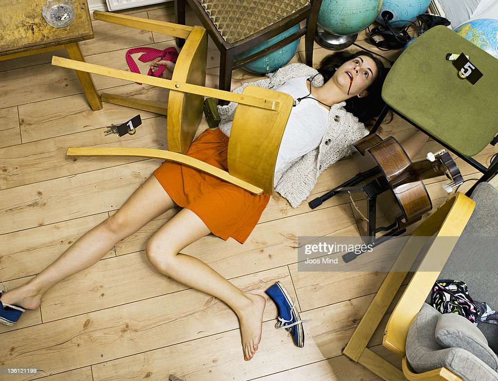 woman lying on living room floor, murdered