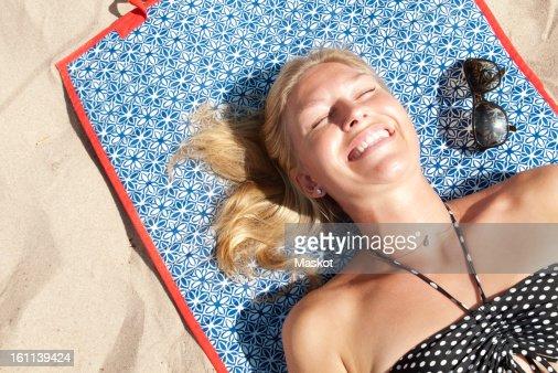 Woman lying on the beach sunbathing