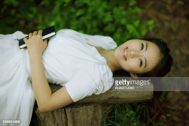 woman lying on the bench
