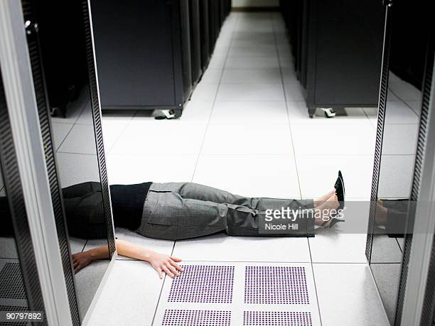 woman lying on the floor in a server room