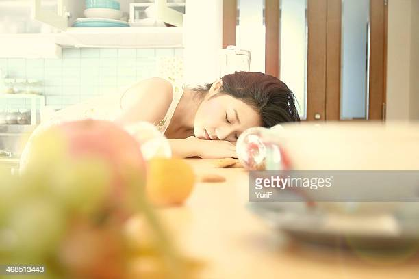 Woman lying on the kitchen table.
