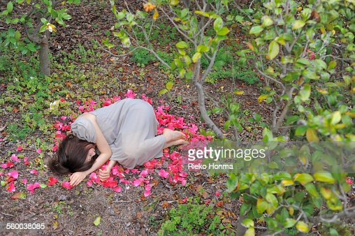 Woman lying on top of the petals