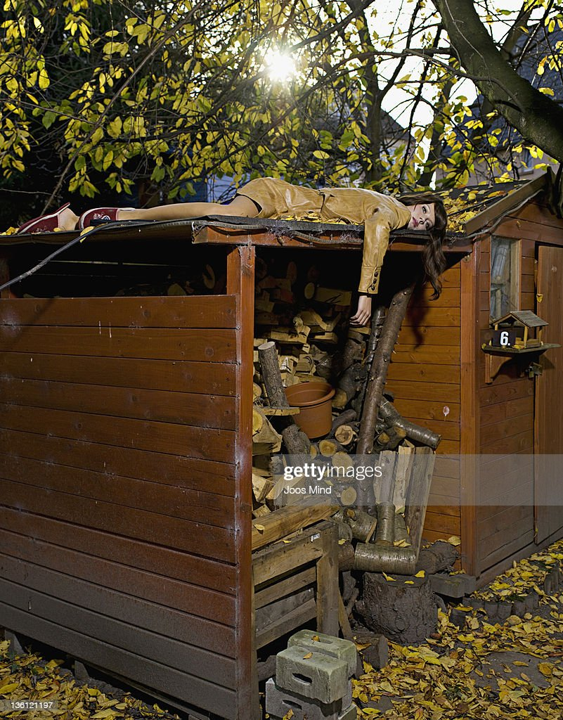 woman lying on utility shed, murdered : Stock Photo