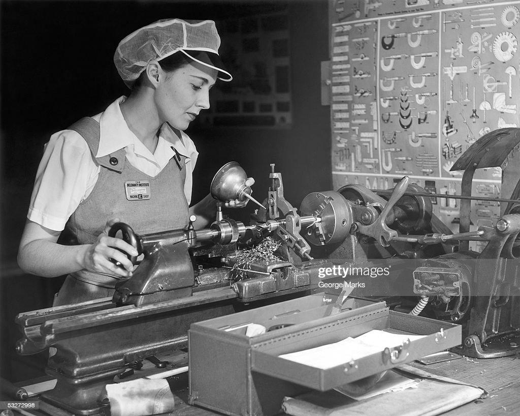 Woman machinist at work : Stock Photo