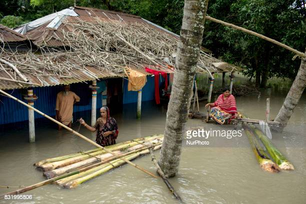 A woman made banana boat for transport when all area under the floodwater at Sariakandhi Bogra Bangladesh 15 August 2017 Floodrelated incidents in...