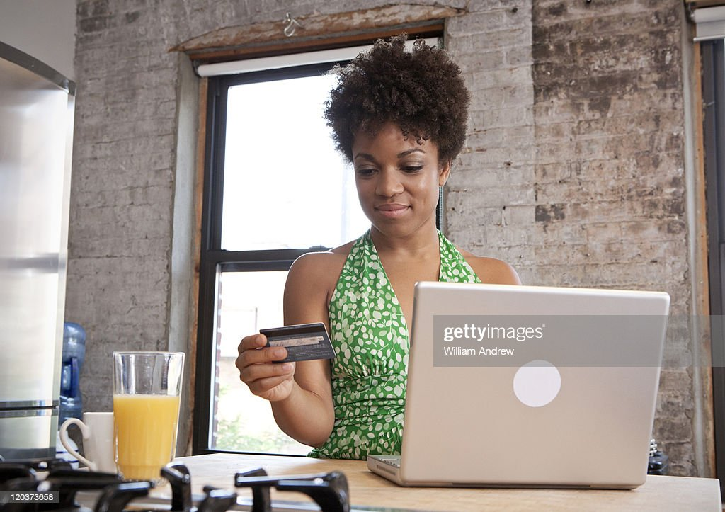 A woman makes an online purchase : Stock Photo