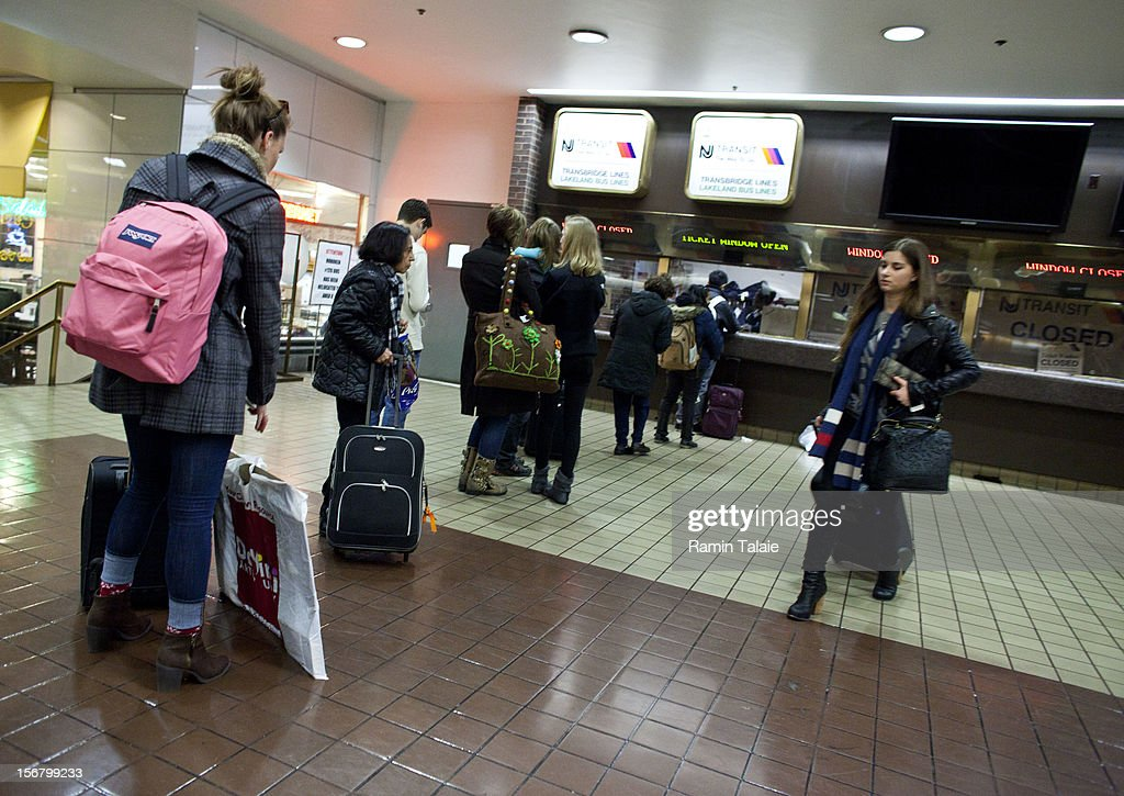 A woman makes her way after purchasing a ticket at the New York Port Authority bus terminal in Manhattan on November 21, 2012 in New York City. The Port Authority of New York and New Jersey is expecting to handle a high number of travelers at its hubs, bridges, and tunnels ahead of the Thanksgiving holiday.