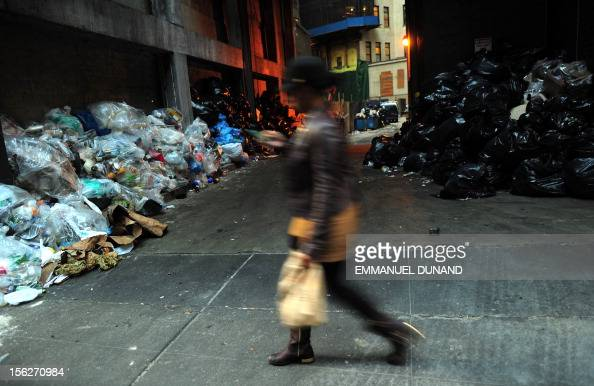 a32fbda6ac A woman makes her way past trash piles in Lower Manhattan in the aftermath  of storm Sandy in New York on November 12