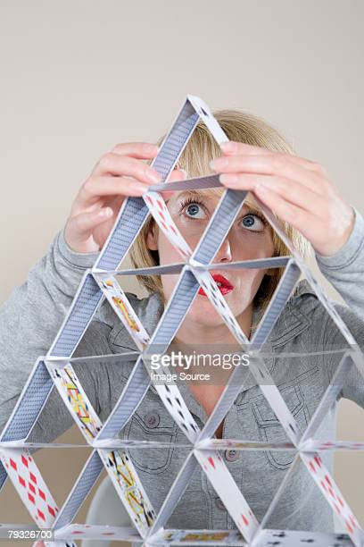 Woman making a house of cards