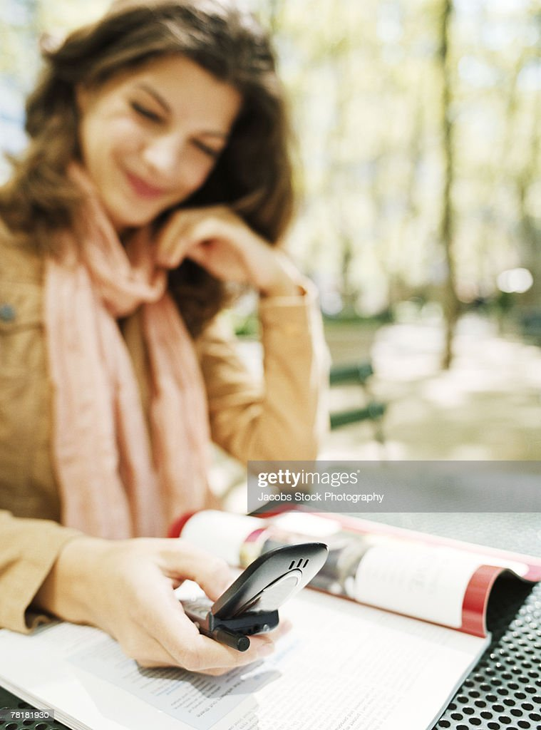 Woman making a phone call in the park : Stock Photo