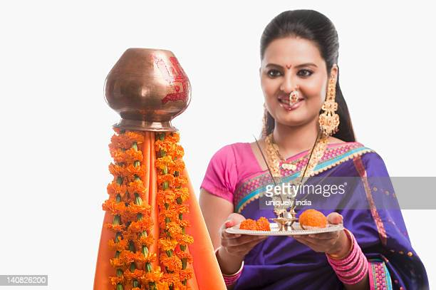 Woman making a religious offerings on Gudi Padwa festival