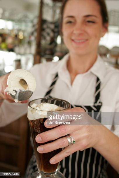 A woman making a root beer float at the Home Farm Store on Washington Street