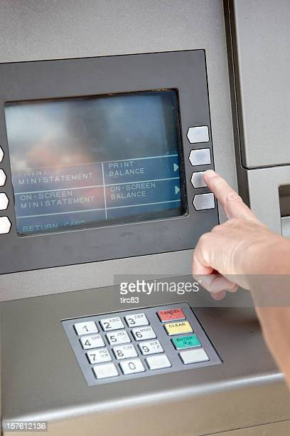 Woman making ATM withdrawal