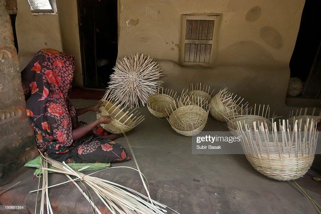 Woman making baskets